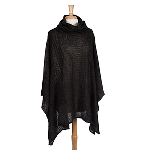 Black turtleneck poncho. 100% Acrylic. One size fits most.