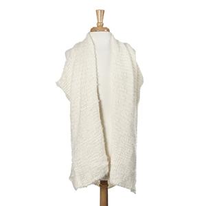 Ivory eyelash kimono vest. 100% Acrylic. One size fits most.