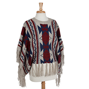 Burgundy, navy, and ivory Aztec inspired poncho with tassels. 100% Acrylic. One size fits most.