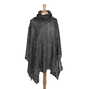 Black and white turtleneck poncho. 100% Acrylic. One size fits most.