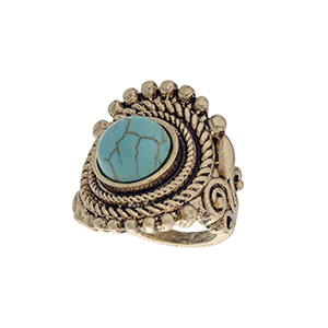 Burnished gold tone bohemian style ring with a turquoise stone focal. Size 7 only.