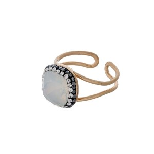 Gold tone adjustable ring with a white opal stone.
