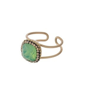 Gold tone adjustable ring with a mint green stone.