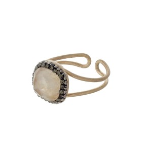 Gold tone adjustable ring with a beige stone.