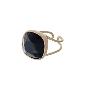 Gold tone adjustable ring with a faceted black stone.