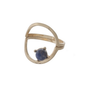 Dainty gold tone, two piece ring with a blue stone. Approximately a size 7.