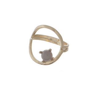 Dainty gold tone, two piece ring with a gray stone. Approximately a size 7.