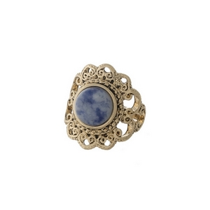 Gold tone scalloped ring with a blue stone focal. One size - approximately a size 7.