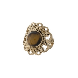 Gold tone scalloped ring with a brown stone focal. One size - approximately a size 7.