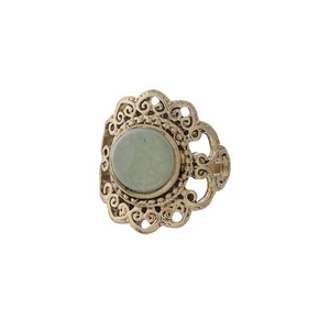 Gold tone scalloped ring with a green stone focal. One size - approximately a size 7.
