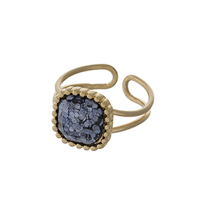 Gold tone adjustable ring with a gray glitter stone focal.