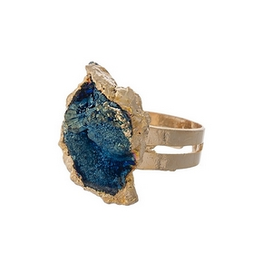 Gold tone adjustable ring featuring a blue natural stone.