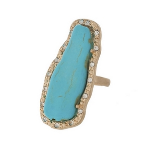 "Matte gold tone adjustable ring featuring a turquoise stone, accented by clear rhinestones. Stone measures approximately 2"" in length."