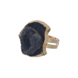 Gold tone adjustable ring featuring a black natural stone.