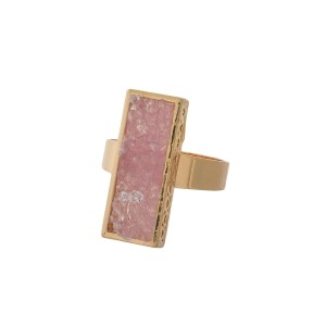 Gold tone ring with a pink faux druzy stone.