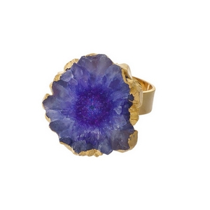 Gold tone adjustable ring with a purple druzy stone.