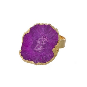 Gold tone adjustable ring with a fuchsia druzy stone.