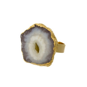 Gold tone adjustable ring with a white druzy stone.