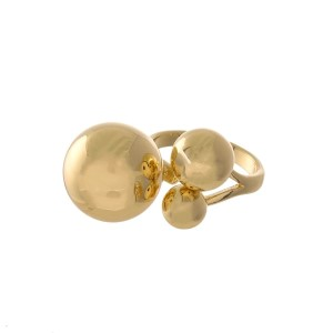 Gold tone, adjustable ring with gold tone bead accents.