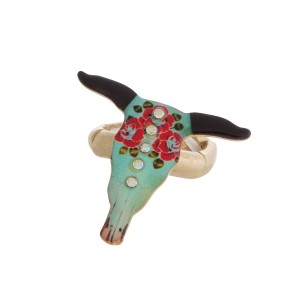 Burnished metal, stretch ring with a steer head focal and floral accents.