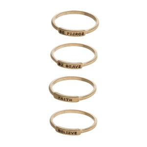 "Four ring set with stamped with ""believe"", ""be brave"", ""faith"", and ""be fierce"". One size, size 7."