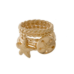 Ring set with sand dollar and star fish detail.