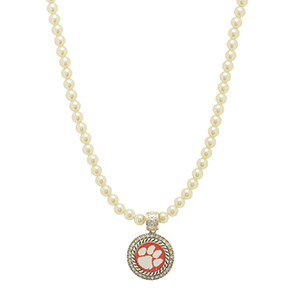"Officially licensed 16"" Ivory pearl beaded necklace featuring a 1"" round silver tone Clemson pendant surrounded by crystal clear rhinestones."