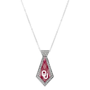 "Officially licensed 18"" silver tone necklace featuring a 2"" tie shaped Oklahoma University logo and clear crystal rhinestones."