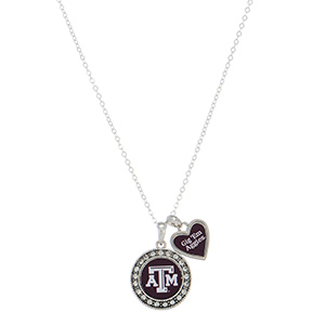 "Officially licensed 18"" silver tone necklace featuring a Texas A & M logo and a heart shaped charm inscribed with ""Gig 'Em Aggies""."