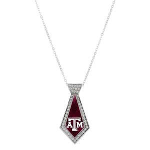 "Officially licensed 18"" silver tone necklace featuring a 2"" tie shaped Texas A & M logo and clear crystal rhinestones."