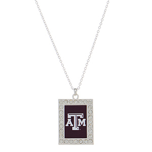 "Officially licensed 18"" silver tone necklace featuring a 1 1/2"" rectangular shaped Texas A & M logo and clear crystal rhinestones."