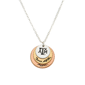 "Silver tone officially licensed collegiate necklace featuring three mixed metal disk stamped ""ATM,"" ""Texas A&M,"" and ""Aggies."" Approximately 17"" in length."