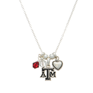 "Silver tone officially licensed collegiate necklace featuring Texas A&M charm. Approximately 17"" in length."