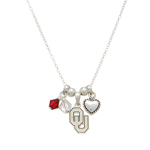 "Silver tone officially licensed collegiate necklace featuring Oklahoma University charm. Approximately 17"" in length."