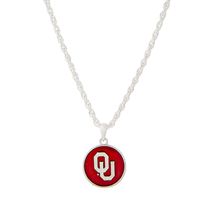 "Silver tone necklace with a red officially licensed University of Oklahoma pendant. Approximately 18"" in length."