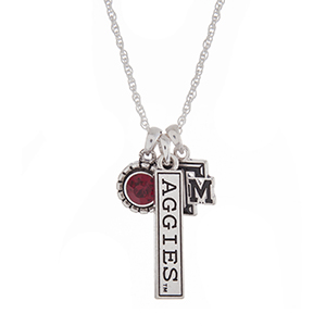 "Officially licensed Texas A&M University silver tone necklace with a maroon rhinestone, logo, and a Aggies stamped bar charm. Approximately 18"" in length."