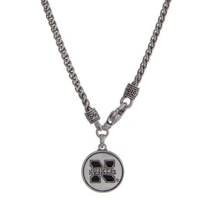 "Officially licensed University of Nebraska silver tone necklace with a front lobster claps and a logo charm. Approximately 18"" in length."