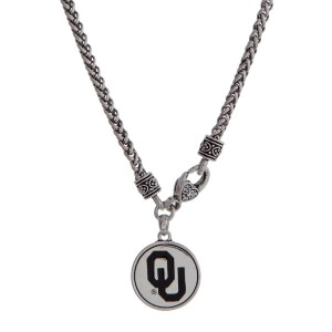 "Officially licensed University of Oklahoma silver tone necklace with a front lobster claps and a logo charm. Approximately 18"" in length."