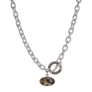 "Silver tone officially licensed University of Missouri toggle necklace with the logo charm. Approximately 18"" in length."