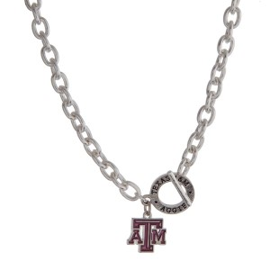 "Silver tone officially licensed Texas A & M University toggle necklace with the logo charm. Approximately 18"" in length."