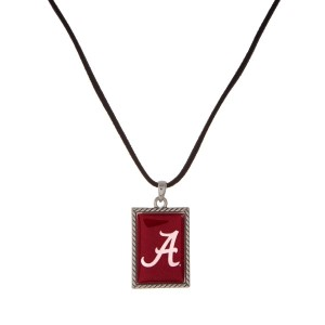 "Officially licensed University of Alabama necklace with black cord and a square logo pendant. Approximately 16"" in length."