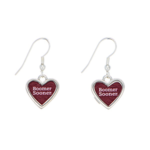 "Officially licensed 1"" silver tone Oklahoma University earrings featuring a heart shape inscribed with ""Boomer Sooner""."