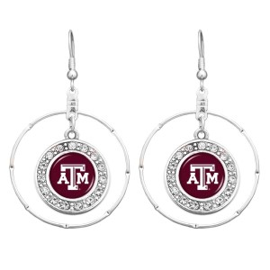 "Officially licensed 2"" silver tone hoop earrings featuring a Texas A & M logo with clear crystal rhinestones."