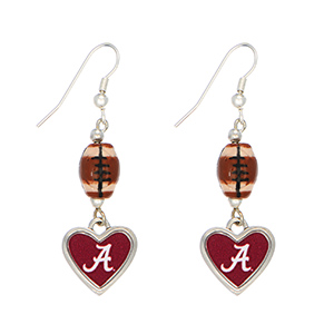 "Officially licensed 2"" silver tone earrings featuring a football and an Alabama heart shaped logo."