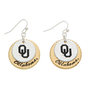 "Silver tone officially licensed fishhook earrings featuring two mixed metal disk stamped ""OU"" and ""Oklahoma"". Charm Approximately 1"" in length. Overall length 1 9/16""."