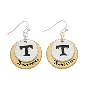 "Silver tone fishhook earrings featuring two mixed metal disk stamped ""T"" and ""Tennessee."" Charm approximately 1"" in length. Overall length 1 9/16""."