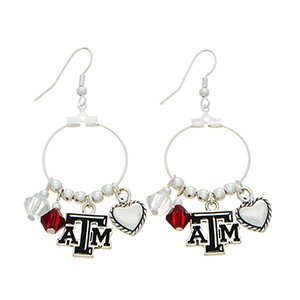 "Silver tone officially licensed fishhook earrings featuring Texas A&M charm. Approximately 1"" in length."