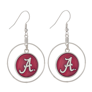 "Silver tone fishhook earrings displaying a ring with a dangling officially licensed crimson University of Alabama charm. Charm approximately 1 1/2"" in length. Overall length 2 1/8""."