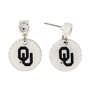 "Silver tone post style earrings with a rhinestone and a dangling officially licensed University of Oklahoma disk. Approximately 1 1/8"" in length."