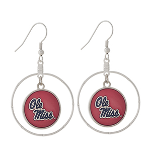 "Silver tone fishhook earrings displaying a ring with a dangling officially licensed red and navy Ole Miss charm. Approximately 1 1/2"" in length."